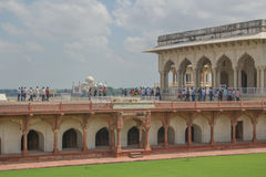Tourists view the Taj Mahal from Agra Fort Stock Photography