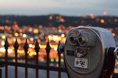 Tourists viewfinder over city lights Stock Photography