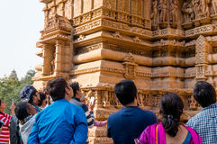 Tourists viewing the carvings at Khajurao Stock Photography