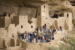 Tourists viewing kiva at Cliff Palace cliff Stock Photos