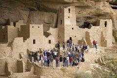 Tourists viewing kiva at Cliff Palace cliff Stock Photos