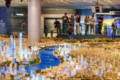 Tourists viewing a large scale model of Shanghai, China. Shanghai, China - October 3, 2017: Tourists viewing a large scale model of the city in the Shanghai royalty free stock photo