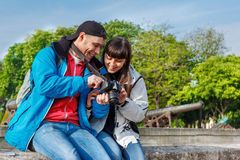 Tourists viewing photos Stock Photos