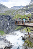 Tourists on a viewing platform near the Trollstigen road between the mountains on June 29, 2016 in Geiranger, Norway Royalty Free Stock Images