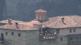 Tourists on a viewing platform of one of the monasteries in Meteora, Greece stock video