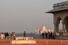 Tourists viewing Taj Mahal from Agra Fort Royalty Free Stock Images