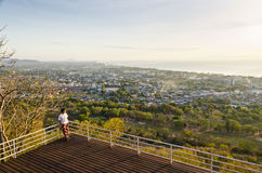 Tourists on viewpoint Hua Hin city at sunrise Royalty Free Stock Images