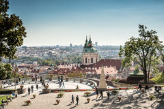 Tourists at viewpoint in Prague: city view and St. Nicholas church Stock Photos