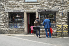 Tourists at Village Shop Royalty Free Stock Photos