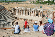 Tourists visit the ancient theater in Turkey Royalty Free Stock Photos