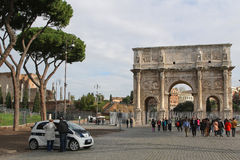Tourists visit Arch of Constantine. ROMA, ITALY, APRIL 3, 2013 : Tourists visit Arco de Constantino (Arch of Constantine). The arch was erected by the Roman Stock Photo