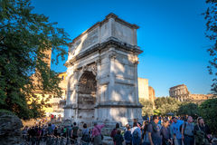 Tourists visit Arch of Constantine. Rome Royalty Free Stock Photos