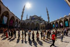 Tourists visit in the Blue Mosque Sultanahmet. Long queue of people for ticket. April 27, 2013. Istanbul, Turkey royalty free stock image