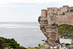 Tourists visit Bonifacio, Corsica. Tourists enjoy the view from the cliffs of Bonifacio on May 6, 2013. During the summer months, the population of the city Stock Photo