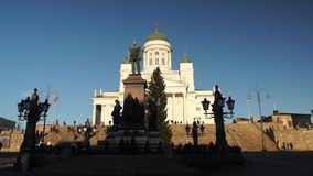 Tourists visit Cathedral at daytime. HELSINKI, FINLAND - DECEMBER 27, 2015: Tourists visit Cathedral at daytime on December 27, 2015 in Helsinki, Finland stock video footage