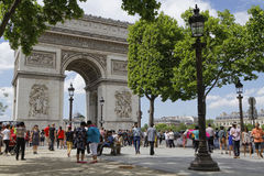Tourists visit the Champs-Elysees. PARIS, France, June 15, 2017 : Tourists visit the Place Charles de Gaulle, historically known as the Place de l`Etoile, and Stock Photography