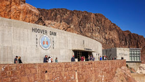 Tourists Visit Exhibition Hall at Hoover Dam. BOULDER CITY, NEVADA - FEBRUARY 9: Tourists visit the exhibition center and Spillway House at Hoover Dam near Stock Photo