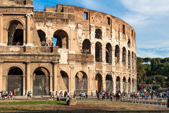 Tourists visit the famous ancient Colosseum in Rome Stock Images