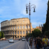 Tourists visit the famous ancient Colosseum in Rome Stock Photo