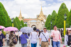 Tourists visit the Grand Palace in Bangkok, Thailand. Stock Photos