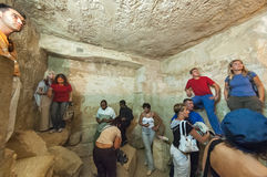 Tourists visit hall inside pyramid of Giza. Egypt Royalty Free Stock Photos