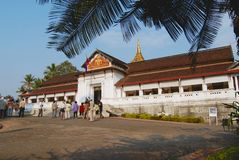 Tourists visit Haw kham Royal Palace in Luang Prabang, Laos. Royalty Free Stock Images