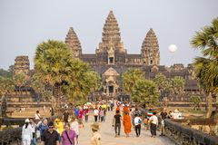 Tourists visit the historic Angkor Wat temple complex Royalty Free Stock Photography
