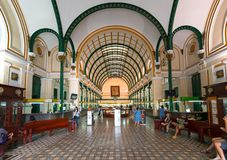Tourists visit Interior of Saigon Central Post Office. Royalty Free Stock Images