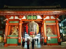 Tourists visit Kaminarimon - entrance gate of Senso-ji Temple in Asakusa, Tokyo, Japan. Royalty Free Stock Photos