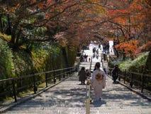 Tourists visit Kiyomizu dera temple. In autumn leaves at Kyoto, Japan Stock Images