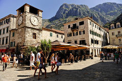 Tourists visit Kotor Square of Arms Stock Photos