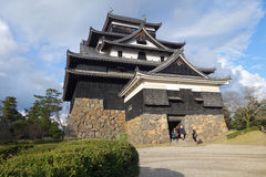Tourists visit Matsue samurai feudal castle in Shimane prefectur Royalty Free Stock Photo