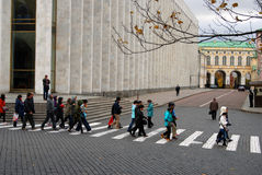 Tourists visit Moscow Kremlin. Color photo. Royalty Free Stock Images