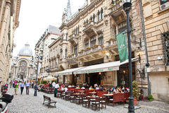 Tourists visit Old Town in Bucharest, Romania. Royalty Free Stock Images