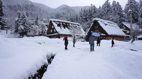 Tourists visit old village in Shirakawa-go, Japan. Royalty Free Stock Photo