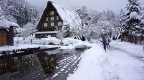 Tourists visit old village in Shirakawa-go, Japan. Stock Photo