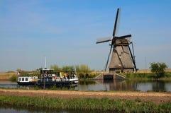 Tourists visit the  old windmill in Kinderdijk, Netherlands