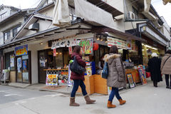 Tourists visit Omotesando Shopping street in Miyajima, Japan Royalty Free Stock Photography