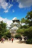 Tourists visit the Osaka castle. Royalty Free Stock Photos