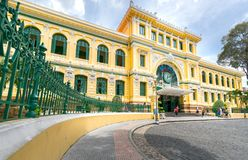 Tourists visit outside Saigon Central Post Office Architecture. Royalty Free Stock Image