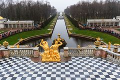 Tourists visit The Peterhof Palace garden. Royalty Free Stock Image