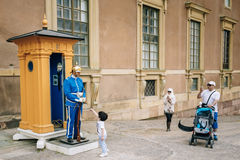 Tourists visit and photograph the guard of honor Stock Image