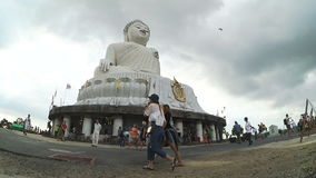Tourists visit  Phra Puttamingmongkol Akenakkiri Big Buddha Statue on island of Phuket stock video