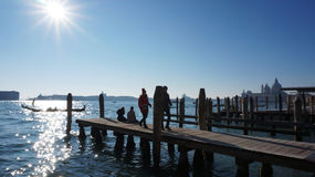 Tourists visit a pier in Grand Canel in Venice Stock Photography