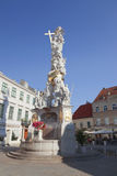 Tourists visit the Plague Column in Baden, Austria. Royalty Free Stock Image
