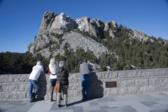 Tourists visit the popular carvings of the presidential faces of Mount Rushmore in the Black Hills. Tourists visit the popular carvings of the presidential faces royalty free stock image