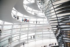 Tourists visit Reichstag dome Central Berlin Germany. Visitors inside the glass dome on the top of Reichstag Building, a seat of the German Parliament Deutscher stock photos