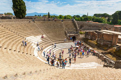 Tourists visit the ruins of the amphitheater in Pompeii, Italy Stock Image