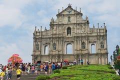 Tourists visit ruins of Saint Paul cathedral in Macau, China. MACAU, CHINA - SEPTEMBER 11, 2013: Unidentified tourists visit ruins of Saint Paul cathedral in Stock Photo