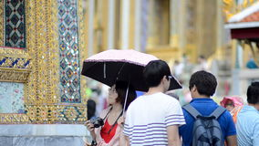 Tourists Visit the Temple of the Emerald Buddha stock video footage